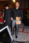 Peter Andre holding Bollywood in Posters book
