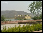 "Jal Mahal (meaning ""Water Palace"") is a palace located in the middle of the Man Sagar Lake in Jaipur.  Across the lake, Aravalli hills can be seen."