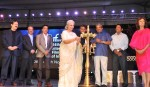 Actress Waheeda Rehman lighting the lamp at the inauguration of the 44th International Film Festival of India (IFFI-2013), in Panaji, Goa on November 20, 2013.  The Minister of State (Independent Charge) for Information & Broadcasting, Manish Tewari, Chief Minister of Goa, Manohar Parrikar, the Secretary, Ministry of Information and Broadcasting,  Bimal Julka, actor Kamal Hassan and Hollywood actress Susan Sarandon are the dignitaries present on stage.