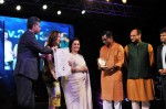 The Minister of State (Independent Charge) for Information & Broadcasting, Shri Manish Tewari and the Hollywood actress Michelle Yeoh presenting the Special Centenary Silver Peacock Award  to  Kamaleshwar Mukherjee, Director of the Film 'Meghe Dhaka Tara'