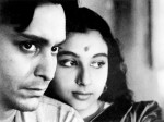 those about to smile eyes, the strand of hair misplaced a sindurer tip, so cozy  (A famous still from Satyajit Ray's Apur Sansar, starring Soumitra Chatterjee and Sharmila Tagore)