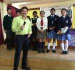 Ramendra Kumar and the student participants at a Creative Writing Workshop