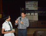 Ramendra Kumar explaining to a student